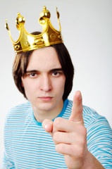 King with crown shows his finger