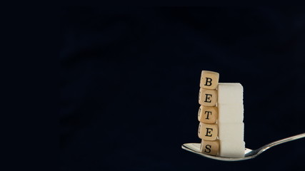 Sugar cubes and diabetes dice vanishing from teaspoon