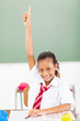 elementary schoolgirl arm up in classroom