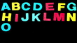 Colourful alphabet appearing on black background