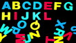 Alphabet forming from pile of letters on black background