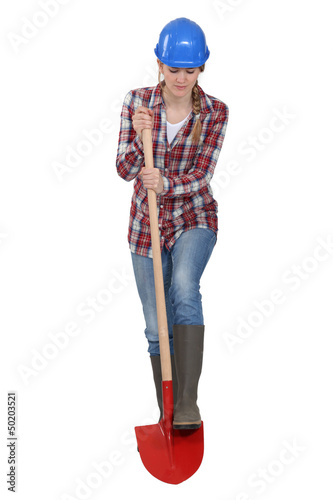 Female laborer digging with shovel