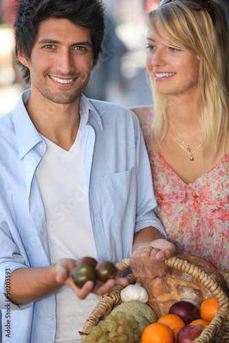 Young couple choosing fruit