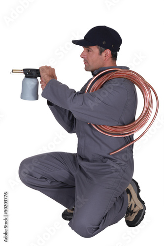 Man aiming a blowtorch