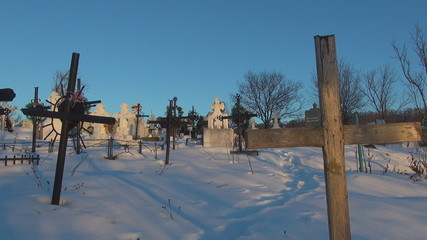 Cross in cemetery during winter time