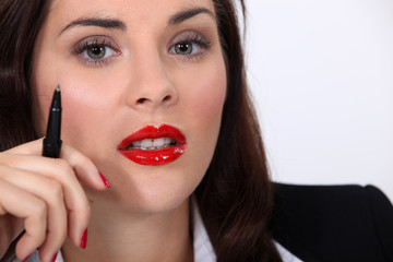 Businesswoman wearing bright red lipstick