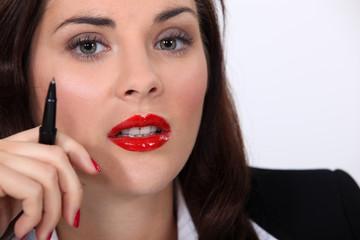 Businesswoman wearing bright red lipstick