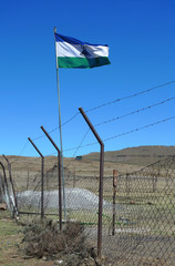Kingdom of Lesotho flag flying at the border with South Africa