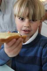 Boy with slice of bread