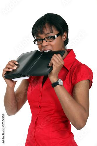 Woman biting diary
