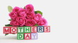Focus on mothers day message with bunch of roses and gift