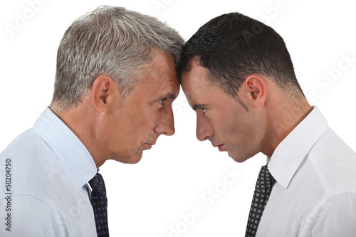 Businessmen stood head-to-head