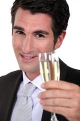 businessman drinking champagne
