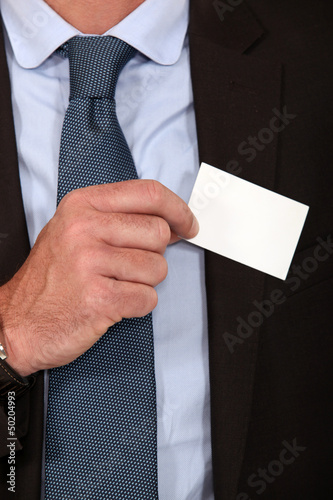 Man removing business card from pocket