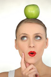 woman with an apple on her head