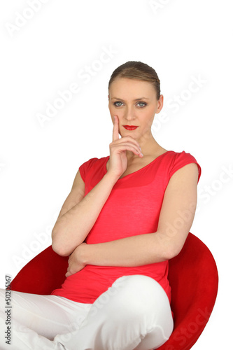 Confident woman in a red chair