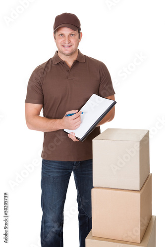 Portrait of delivery man doing paperwork