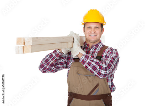 Carpenter with wooden planks