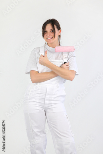 Woman with paint-roller