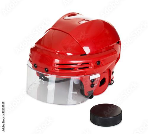 Hockey helmet and puck