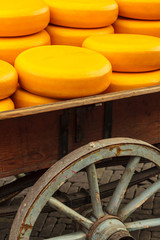 Old wagon filled with Dutch cheese