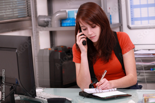 Woman laborer on phone scheduling an appointment