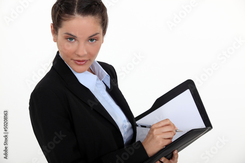 young businesswoman with agenda flirting with camera