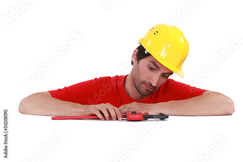 Man playing with a pipe wrench