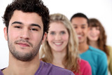 Young people standing in a row