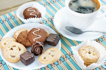 Various Sweets And Cup Of Coffee