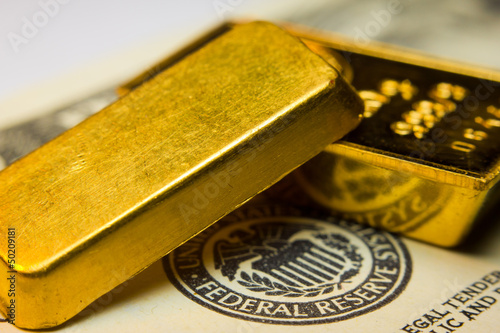 Close-up of a 20 dollar banknote note and gold bullions