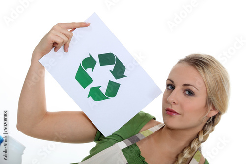 Woman holding recycle logo