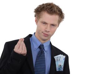 Successful businessman with cash