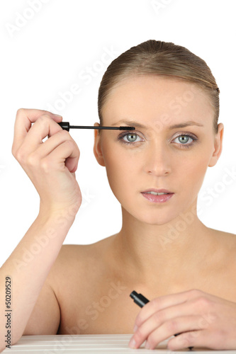 Woman putting some make-up on