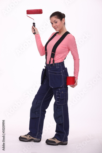 Woman in overalls ready for painting