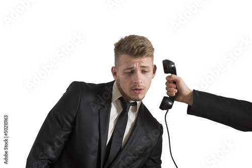 Businessman surprised by a call