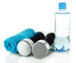 Dumbbells with towel and bottle of water isolated on white