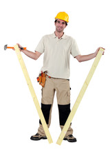 Worker holding two planks of wood