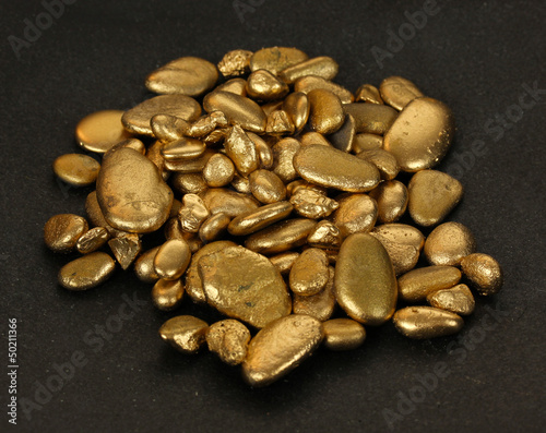 Golden stones on black background