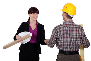 Businesswoman greeting a colleague