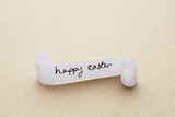 Happy easter message written on paper scroll