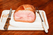 Ham on Cutting Board with Knife and Fork