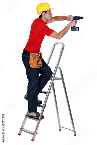 Determined tradesman using a power tool