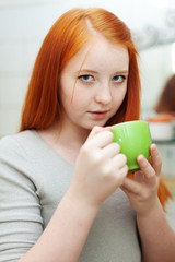 red-haired teen girl gargling throat