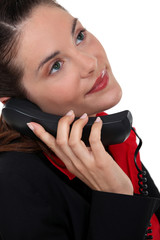 portrait of woman talking on the phone
