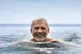 Elderly man swimming - Fine Art prints