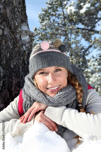 Happy blond woman in the snow