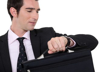 Businessman checking he is not late