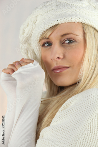 Pretty blonde in white wool cap and jumper