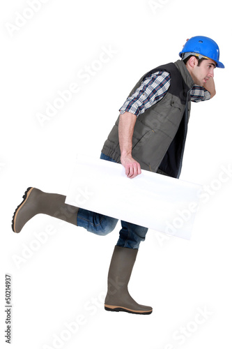 Speedy tradesman holding a blank sign